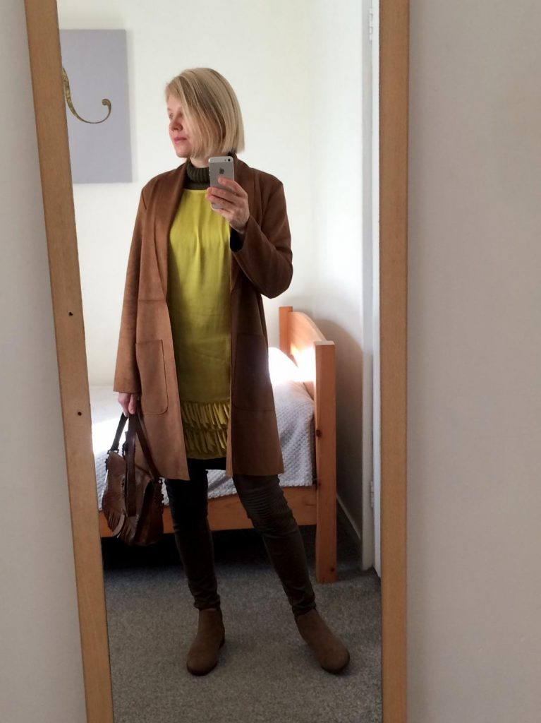 Chartreuse, summer dress worn with an army green polo neck, army green trousers, brown long coat and brown, vintage bag.Outfit ideas for real people, styling on a budget